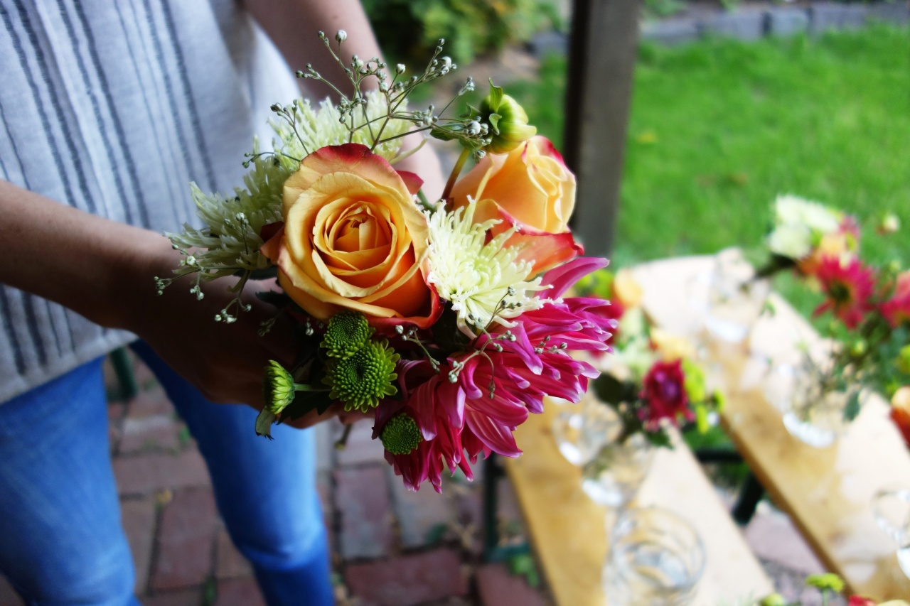 Take-home posies of babys breath and chrysanthemum buds