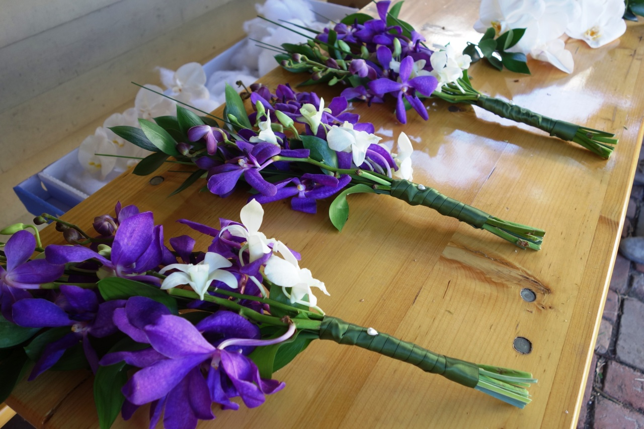 Bridesmaids bouquets of white and purple orchids