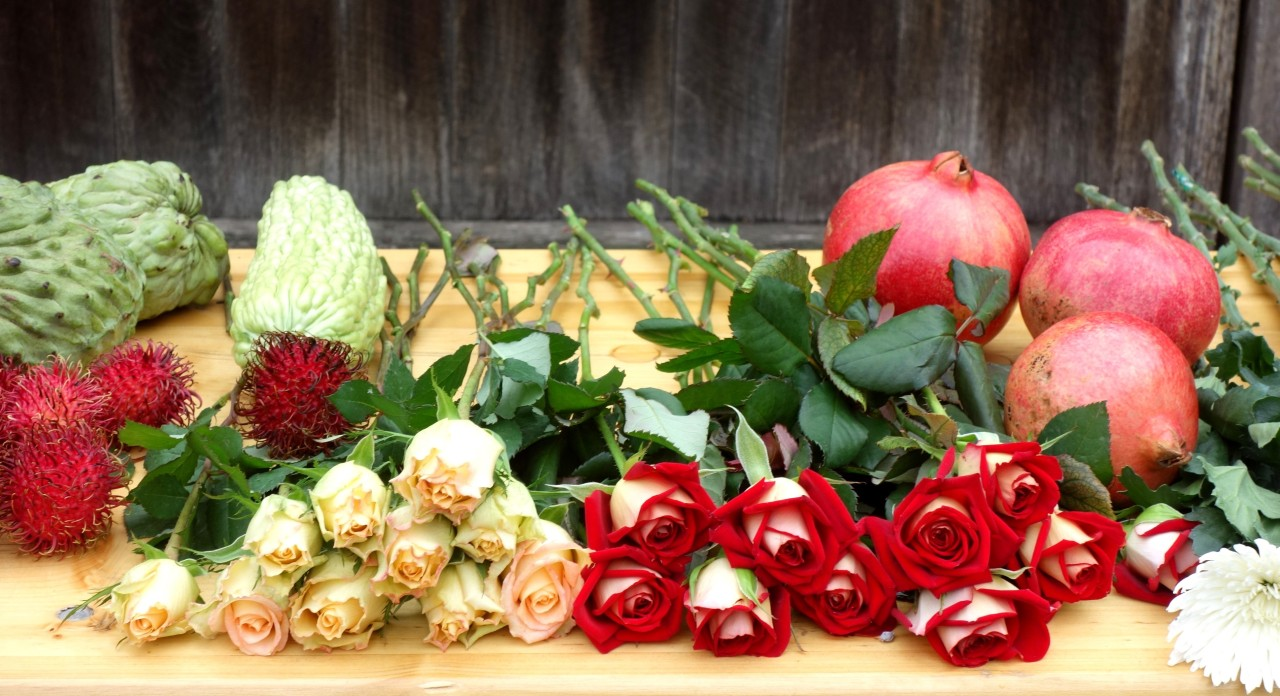 Roses and fruit for arrangement