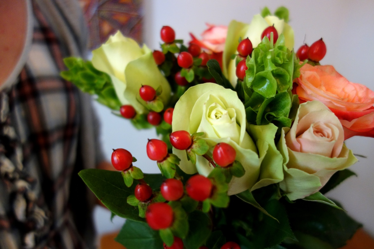 Roses arranged with berries for bouquet