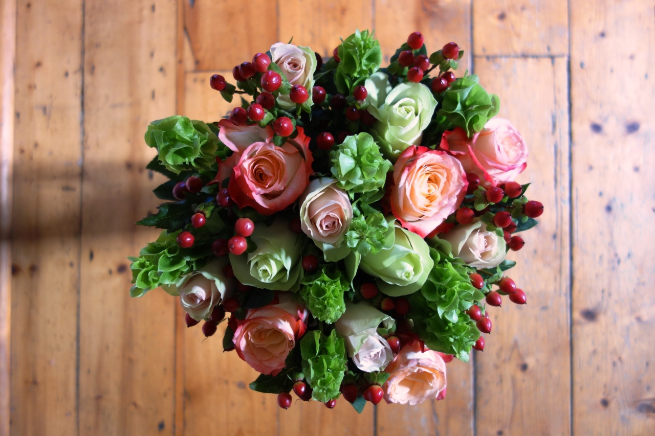 Green red roses and other flowers in bouquet