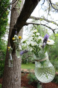 Billy buttons, Easter daisies, asters & lavender in glass jars