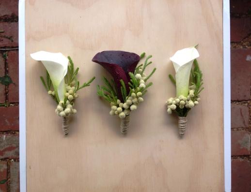 White & purple calla lily boutonnieres
