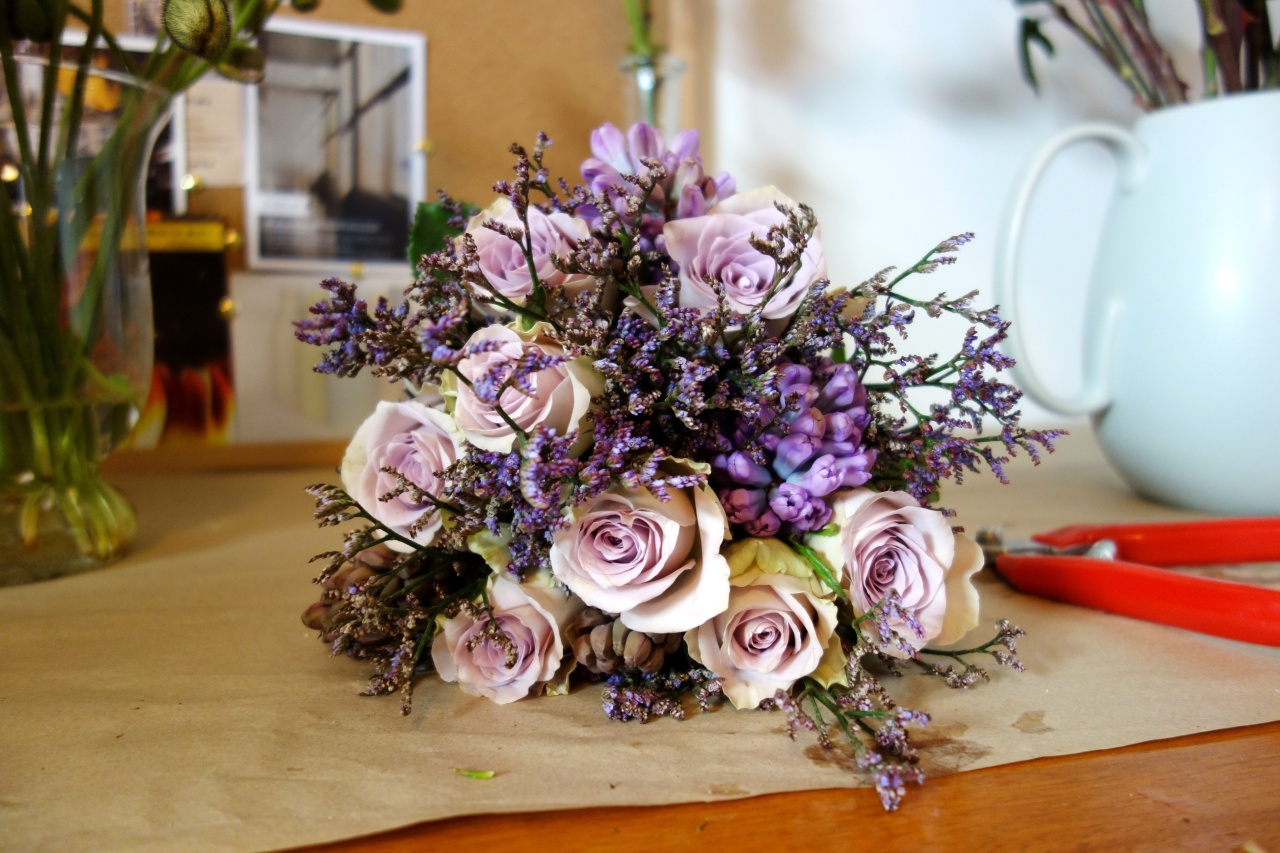 Misty, hyacinth and morning dew roses in wedding bouquet