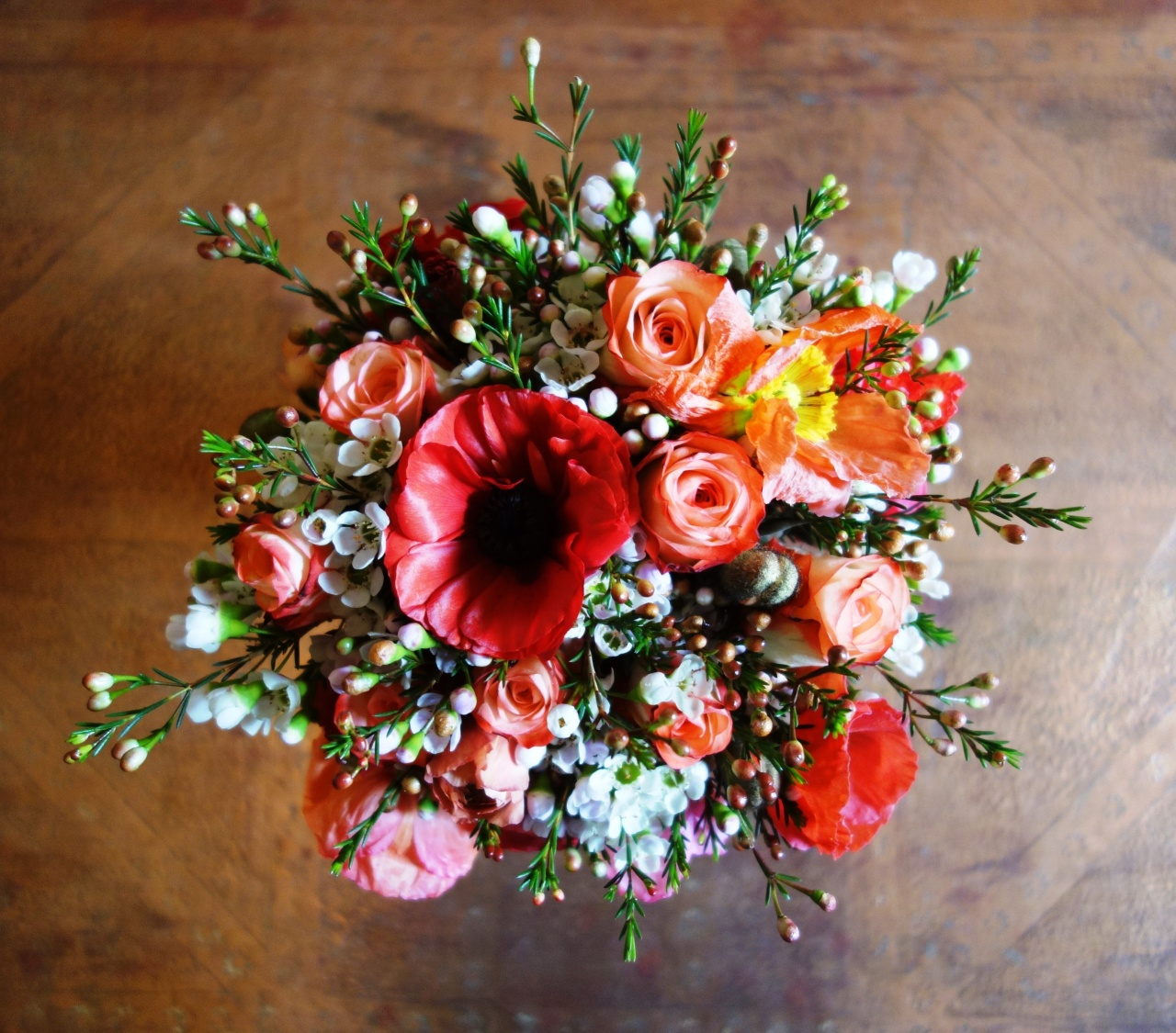Poppy, ranunculus, waxflower and rose wedding bouquet