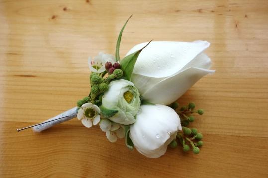 White rose & ranunculus boutonniere