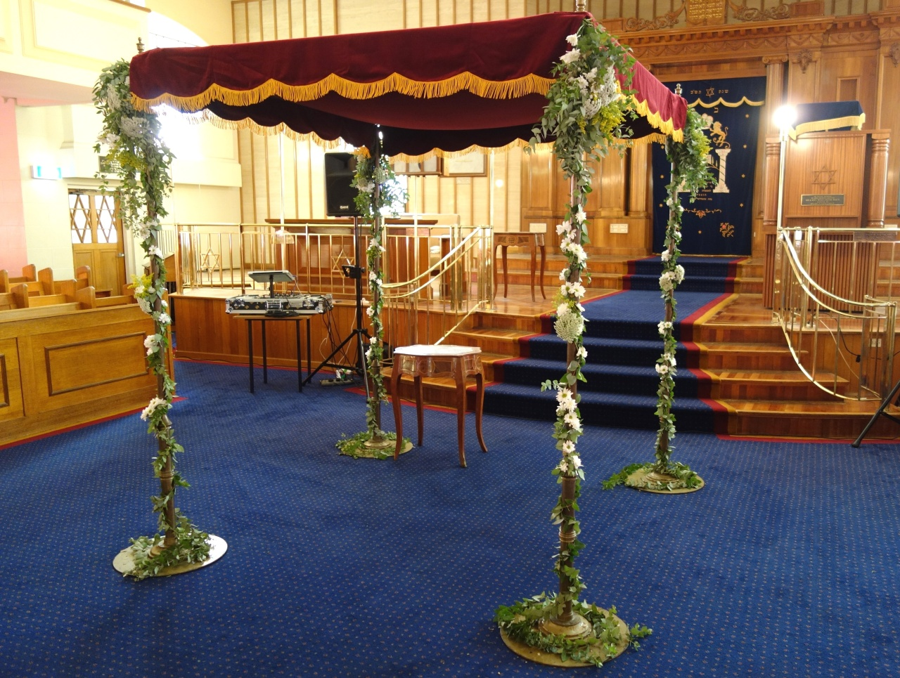 Chuppah styled with daisies and other flowers
