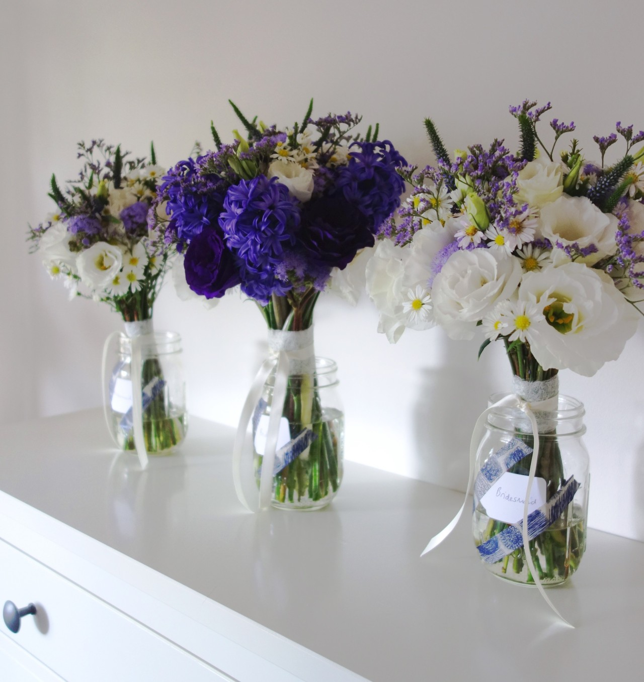 Lissianthus, hyacinth, ageratum, veronica, misty & Easter daisy bridal bouquets