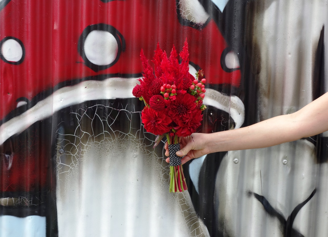 Celosia feather, dahlia & berry bouquet with graffiti