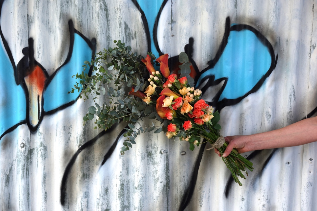 Rose, calla lily, berry & eucalyptus bouquet with graffiti